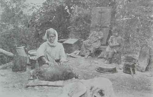 Armenian woman preparing the butter