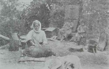 Armenian woman preparing the butter