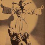 John Yervant in a Caucasian flaming sword dance with Felice watching